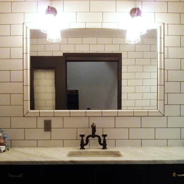 Art Deco Styled Bathroom Created With White Subway Tile