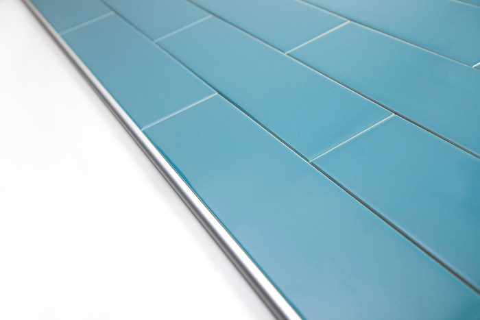 5th Avenue Turquoise Subway Tile With Schluter Silver Rondec